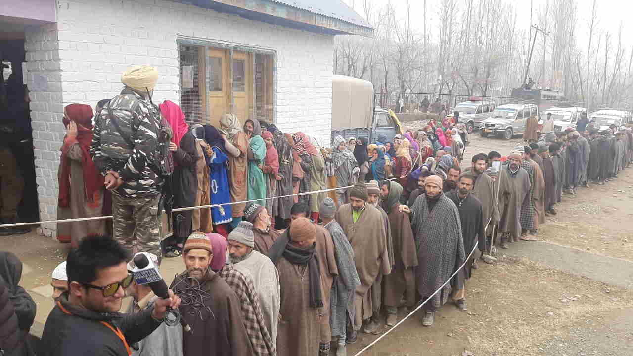 Voters at a polling station to cast their votes for District Development Council (DDC) elections in Jammu and Kashmir