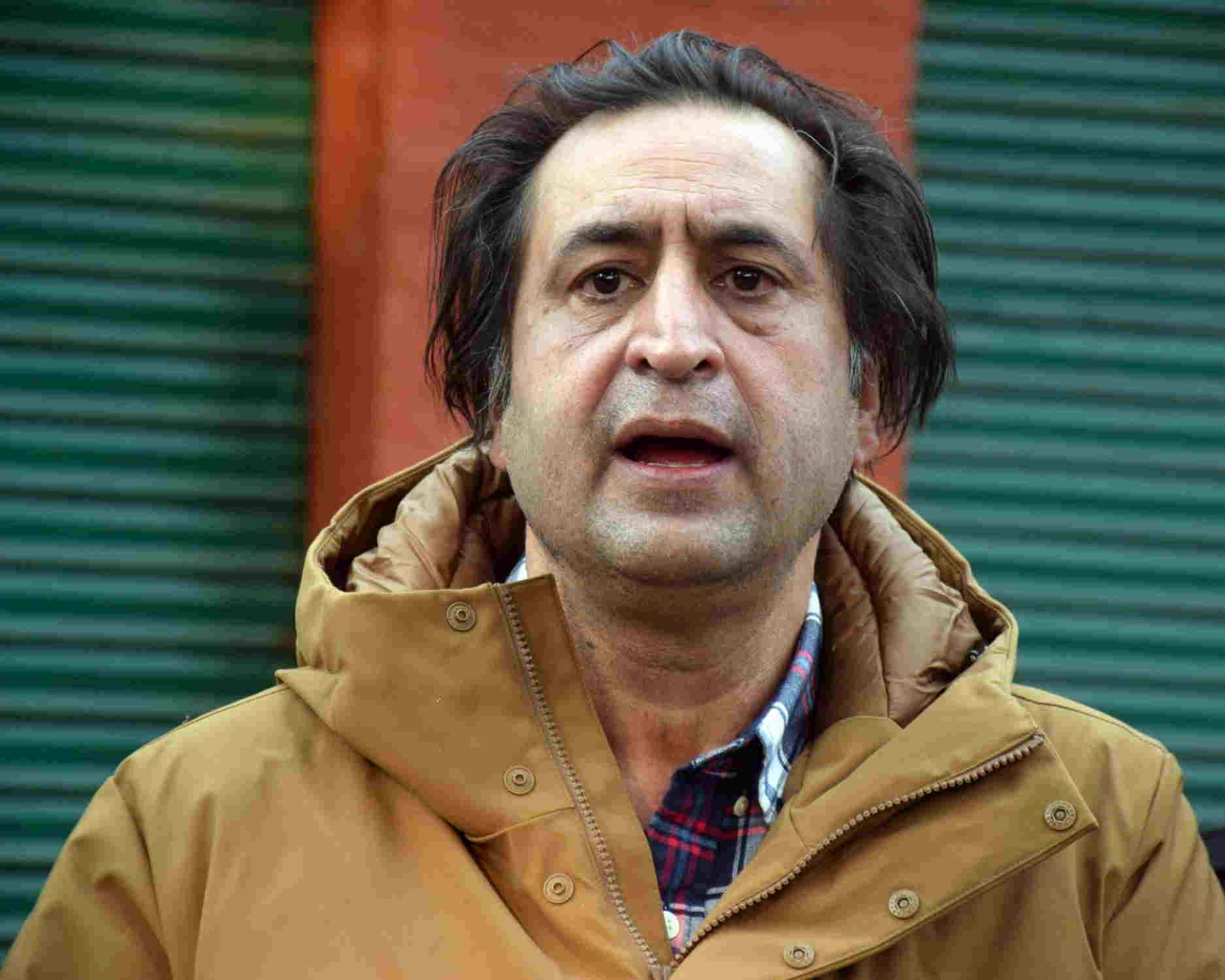 Sajad Lone talks to the media after the first meeting of the People's Alliance for Gupkar Declaration (PAGD) in Srinagar  last month (IANS)