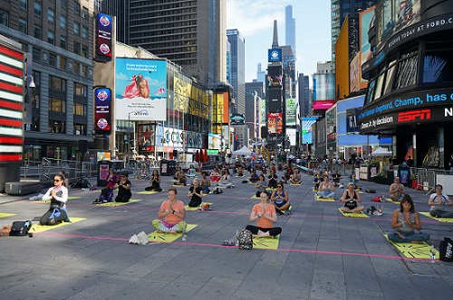 Yoga in the heart of New York! International Yoga Day being celebrated at the iconic Times Square in New York on Sunday (Image courtesy: Consulate General of India, New York)