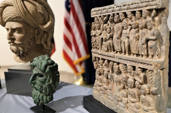 The crimes of culture involving looted and stolen religious relics, such as the nearly two dozen Buddhist statues being repatriated to Afghanistan, not only tear at the societal fabric of nations but also deprive millions of believers worldwide of the earliest sacred symbols of their faith (Images courtesy: Twitter/@HSINewYork & Embassy of Afghanistan, Washington)
