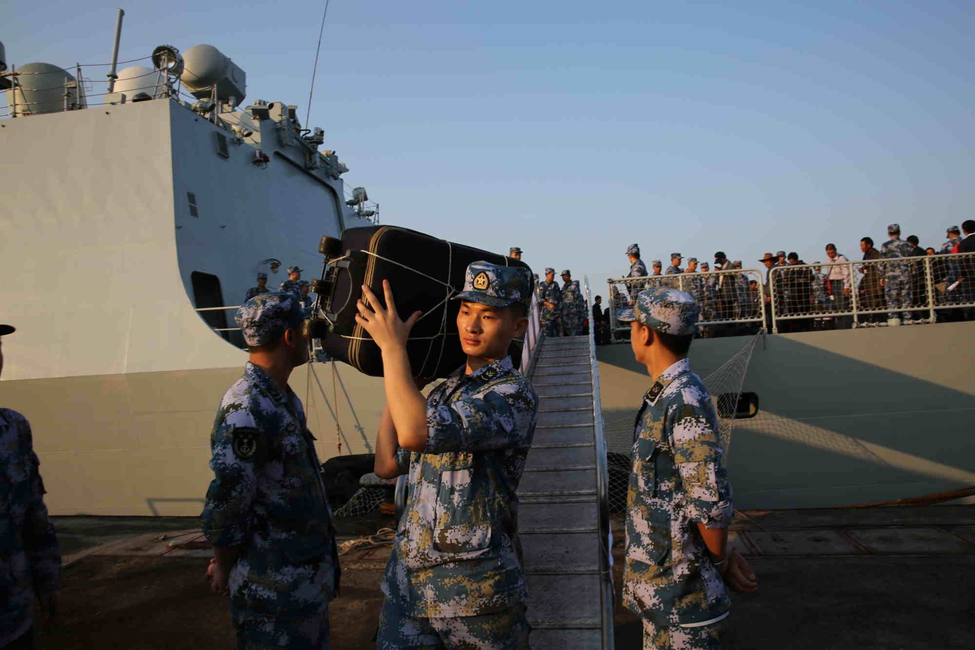 A file image of a navy personnel helping the Chinese evacuees who arrived in Djibouti from conflict-ridden Yemen (Xinhua/Pan Siwei/IANS)