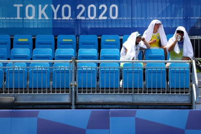 Scorching heat, signs of typhoon cause concern at Tokyo Olympics
